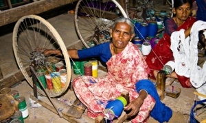 MDG : Woman working at spinning wheel in a weaving factory, Madurai, Tamil Nadu, India