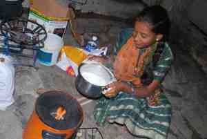 Woman-cooking-milk with gas