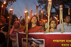 Dhaka, Bangladesh. 13th May 2015 -- Ganajagaran Mancha activities hold a torch-light rally demanding immediate arrest and exemplary punishment to the killers of writer-blogger Ananta Bijoy Das in Dhaka, Bangladesh. On May 13, 2015. -- Ganajagaran Mancha activities hold a torch-light rally demanding immediate arrest and exemplary punishment to the killers of writer-blogger Ananta Bijoy Das. Das was an activist with the Ganajagaran Mancha movement.