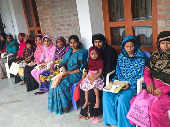 Women in Bangladesh wait their turns to be examined by a traditional birth attendant. New technology could save the lives of mothers and newborns. The public is invited to vote to help provide funding to develop that technology.