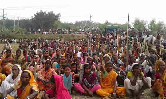 Tea workers protest against the government's acquisition of agricultural land at the Chandpore Tea estate in northeastern Habiganj district. (Photo by Mohan Rabidas)