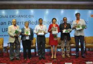 """Mr. Abdul Malek (third from left), Secretary, Local Government Division launching the report along with other guests in a workshop """"Regional exchange on urban poverty reduction in Bangladesh"""" organized by UPPR."""
