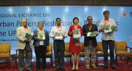 "Mr. Abdul Malek (third from left), Secretary, Local Government Division launching the report along with other guests in a workshop ""Regional exchange on urban poverty reduction in Bangladesh"" organized by UPPR."