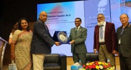 Nadia Anwar, Chairman of AIUB Board of Trustees presents a plaque of appreciation to Road Transport and Bridges Minister Obaidul Quader, MP after a lecture series on Road Act 2019 held at the city's American International University-Bangladesh on Monday.